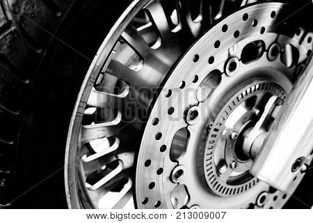 Isolated motorcycle front wheel in black and white / Close up view of motorcycle front wheel