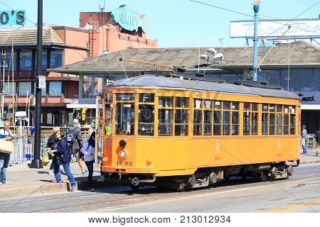 San Francisco United States - September 21 2017: Orange vintage Swiss Firsherman's Wharf streetcar in it's Fisherman's Warf station. Fisherman's Wharf on the northern waterfront is one of the city's busiest tourist areas