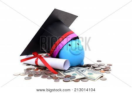 Congratulation Concept: Piggy Bank With A Graduation Hat With The Concept Of Scholarship Funding