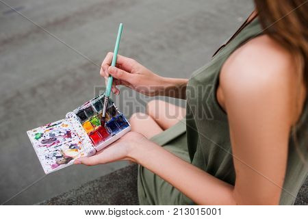 Inks artist colourful woman creative concept. Brighten up the gray routine. Lifestyle of a painter.