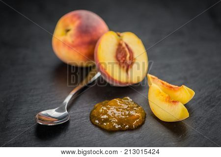 Portion Of Peach Jam On A Slate Slab