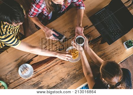 Group of Friends are chitchatting during meal in cafe.