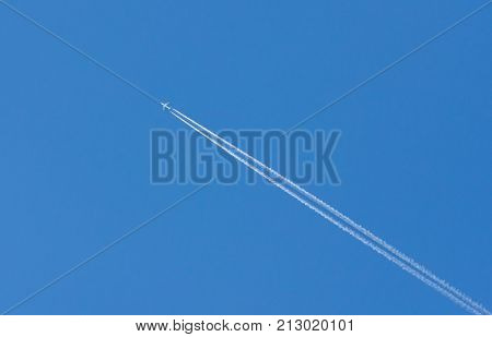 plane is flying on a blue sky .