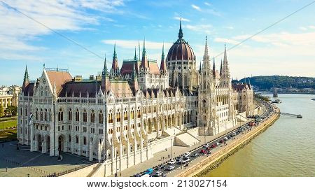 Aerial footage from a drone shows the historical Buda Castle near the Danube on Castle Hill in Budapest, Hungary. Bridge on the river. Aerial view.