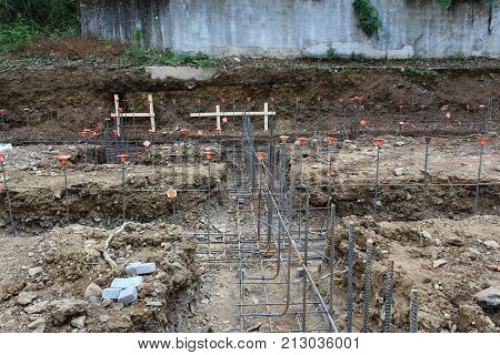 Construction Site View Over Unpoured Footings With Steel Rebar Gridwork, Horizontal View
