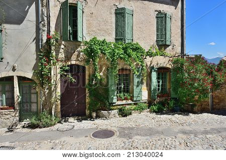 France Provence. Vaison la Romaine. Typical medieval houses decorated with green plant and flowers in pots