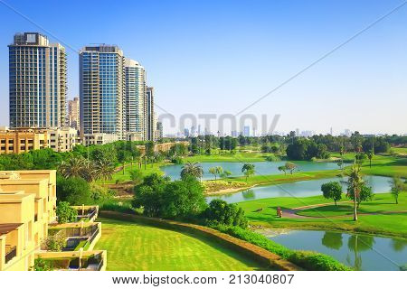 Dubai luxury residential district with golf club on a sunny day. Background for real estate themes.