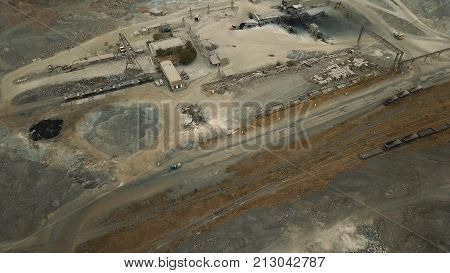 Aerial view. Slag storage on the coast. A place for the storage of the slag. Large slag mountains. Slag pit