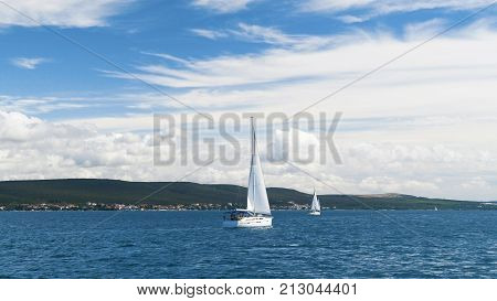 Sailing. Ship yachts with white sails in the Sea. Luxury boats. Boat competitor of sailing regatta.