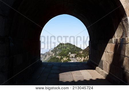 A stone archway gives a view of one of Tai Shan's summit peaks in Shandong Province China
