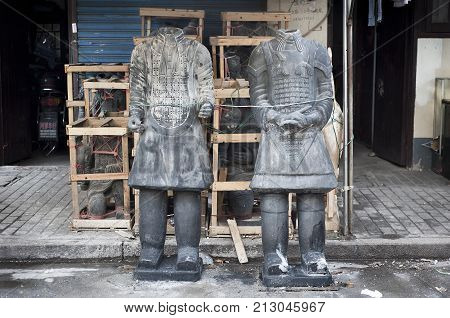 SHANGHAI, CHINA - DEC 30, 2012 - Two headless Terracotta Warriors at Dongtai Road Antique Market, Shanghai