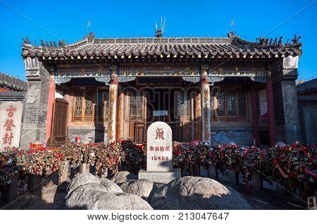 TAISHAN, CHINA - JAN 2, 2014 - Height marker and love locks at Jade Emperor Temple on the summit of Tai Shan, China