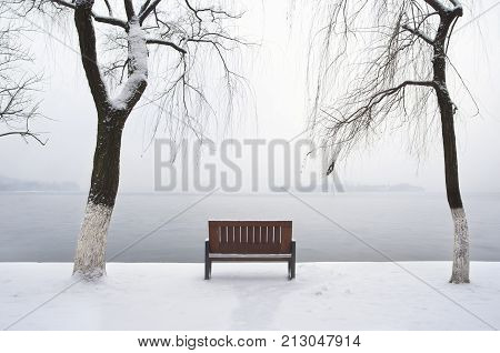 Lonely winter bench beside West Lake Hangzhou
