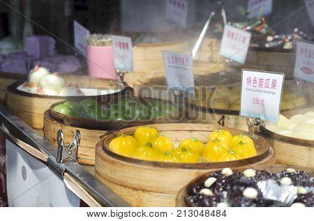 SUZHOU, CHINA - MARCH 31, 2013 - Sweet snack stall on Pingjiang ancient street, Suzhou, China