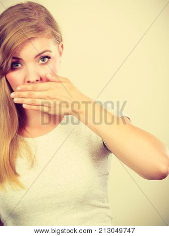 Ashamed Woman Having Hand On Mouth