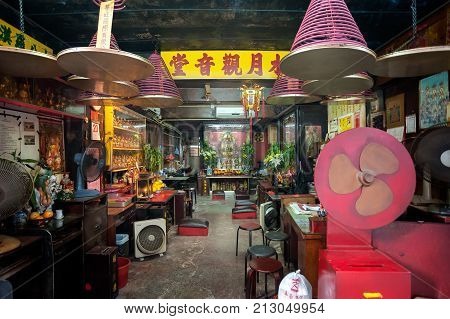 HONG KONG - SEPT 20, 2013 - Interior of a small Taoist Temple on Tai Ping Shan Street, Sheung Wan, Hong Kong Island. The area around Tai Ping Shan is one of the oldest neighbourhoods in Hong Kong.