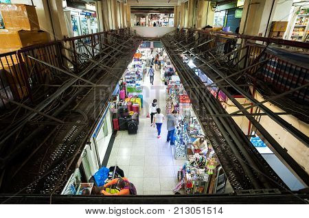 CHUNGKING MANSIONS, HONG KONG - MARCH 27, 2014 - Elevated view of the ground floor shopping mall at Chungking Mansions, Hong Kong. Chungking Mansions is located on Nathan Road in Hong Kong's Tsim Sha Tsui district. It consists of 17 stories of low-budget