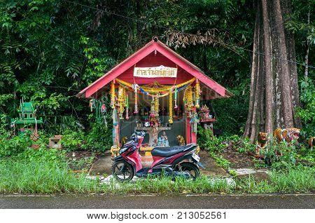 KOH CHANG, THAILAND - JUNE 18, 2015 - Roadside shrine on Koh Chang, Thailand.