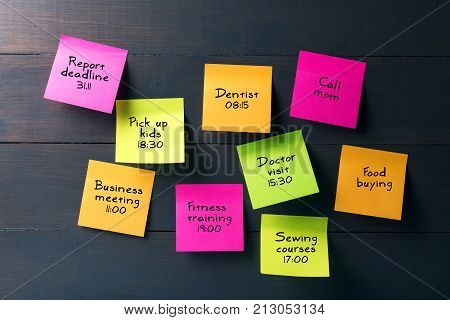 colorful sticky notes with busy woman schedule