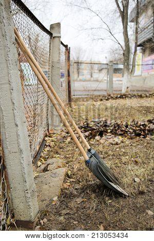 Shovel And Broom Tools Harvesting Autumn Leaves