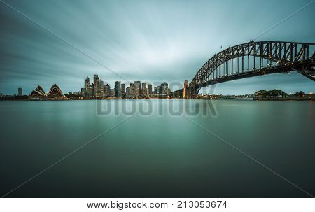 Evening skyline of Sydney downtown  with Harbour Bridge, NSW, Australia. Long exposure.