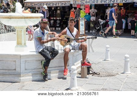 Chania Crete Greece - June 27 2017: Street musicians perform in the streets of Chania Crete