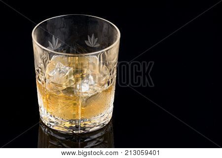 Whiskey With Ice In Rocks Glass Isolated On Black Background With Clipping Path
