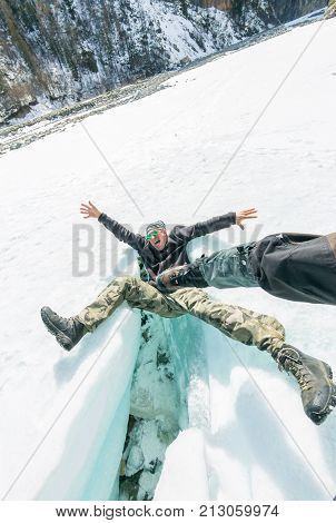 The Man Falls From The Screams From A Blow To The Crack Of The Glacier