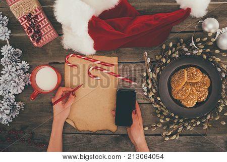 Woman With Smartphone On Christmas