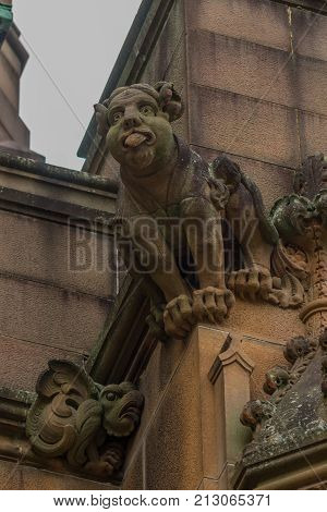Sydney Australia - March 25 2017: Closeup of brown stone gargoyle of historic Nicholson Museum facade.