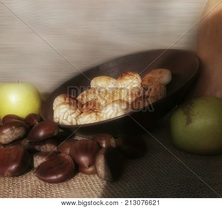 Still life with nuts, fruits and sweets from Autumn