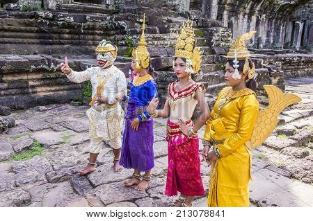 SIEM REAP CAMBODIA - OCT 15 : Cambodians Apsara dancers in Angkor Wat Siem Reap Cambodia on October 15 2017. The Apsara dance is a traditional dance of Cambodia.