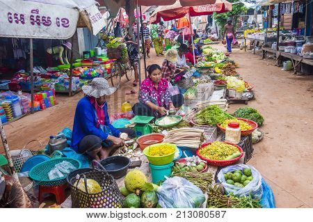 SIEM REAP CAMBODIA - OCT 18 : Cambodian women selling vegetables in a market in Siem Reap Cambodia on October 18 2017. Agriculture is the main industry in Cambodia