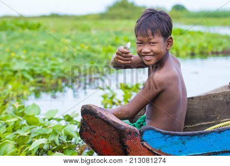TONLE SAP CAMBODIA - OCT 18 : Cambodian child in Tonle sap lake Cambodia on October 18 2017. Tonle sap It is the largest lake in South East Asia