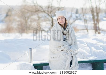 Girl Drinking Hot Tea From A Thermos
