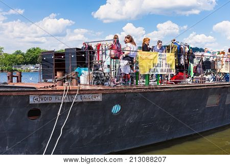 PRAGUE, CZECH REPUBLIC - JUNE 10, 2017: Prague Naplavka flea market on board Avoid in the weekend. Market has antiques, farm food and drinks.
