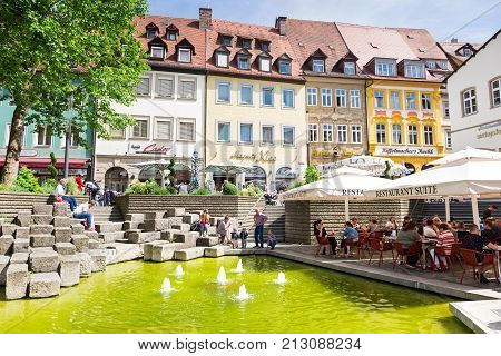 BAMBERG, GERMANY - JUNE 8, 2017:  Restaurants and shops around Obstmarkt  fountain square, Upper Franconia, Germany. Resting place for tourists.