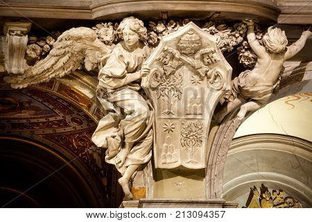 ROME, ITALY. February 24. 2015: Angel. Santa Maria del Popolo Church, details. Rome. Italy. Church of Santa Maria del Popolo in Piazza del Popolo in Rome, Italy. An angel carved above a column.