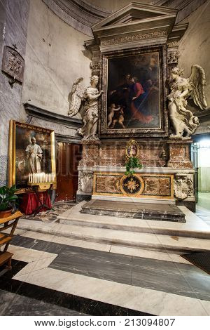 ROME, ITALY. February 24. 2015: Altar with paintings, statues and tabernacle inside the Santa Maria del Popolo Church. Right aisle. Rome. Italy.
