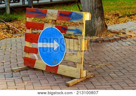 Sign of detour travel. Pit on the road. repair work sign circumvent bypass
