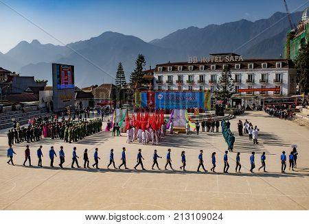 SAPA VIETNAM - NOV42017 : youth marching in grand opening of sapa town event in center of township sapa important town of lao cai province and most popular traveling destination in north west vietnam