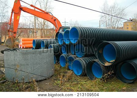 Pipes of PVC large diameter prepared for laying on construction site poster