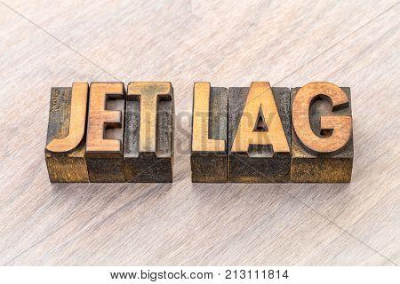 jet lag - word abstract in vintage letterpress wood type printing blocks