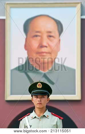 BEIJING, CHINA - OCT 25, 2009 - Guard standing in front of the famous portrait of Chairman Mao, Tiananmen Gate, Beijing