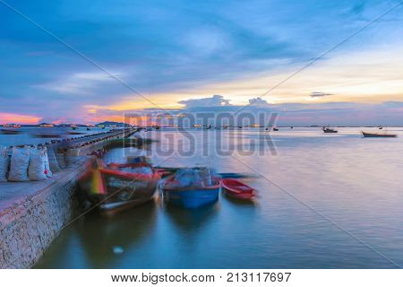 SIRACHA THAILAND - AUGUST 10: Evening view of Boats docked at a pier in Sriracha city on August 10 2017 in Siracha