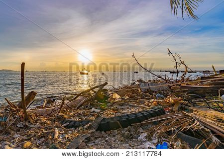 Polluted beach during sunset in Siracha Thailand