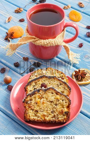 Cup Of Tea And Fresh Baked Homemade Fruitcake On Plate