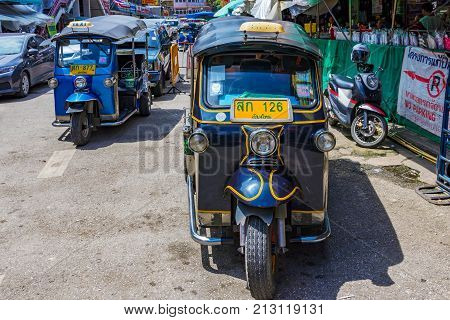 CHIANG MAI THAILAND - JULY 29: Tuk tuk's parked in the downtown area of Chiang Mai on July 29 2017 in Chiang Mai