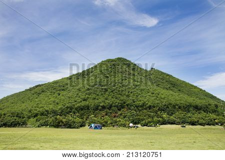 Travelers People Build Tent Camping On Grass Field For Rest And Sleep Near Mountain At  Chang Hua Ma