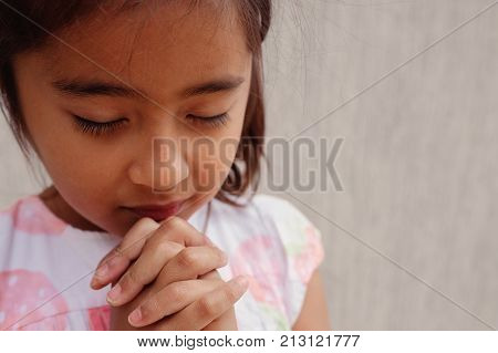 Multicultural Hispanic Girl Child Praying With Eyes Closed, Christianity Faith Concept